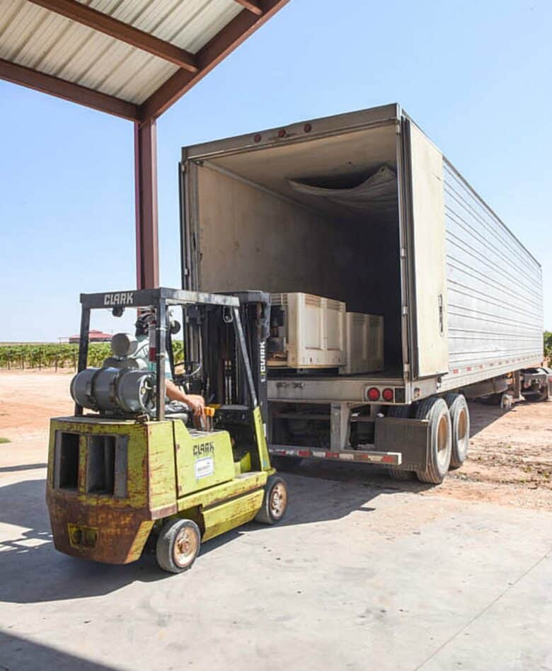 Loading semi with single stacked bins