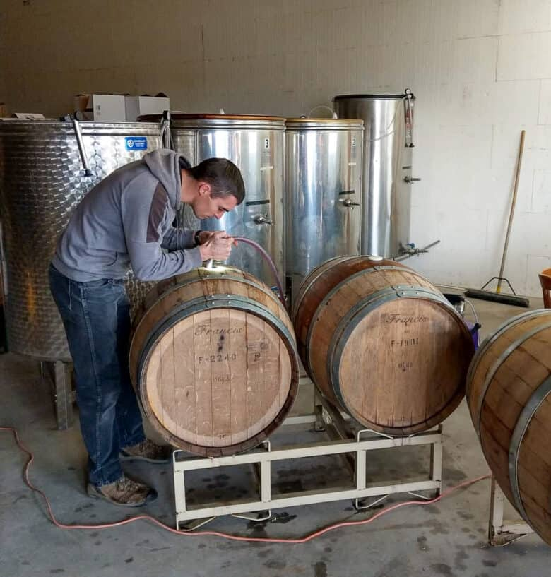 Wine - from Tanks to Barrels - Silas filling a barrel.