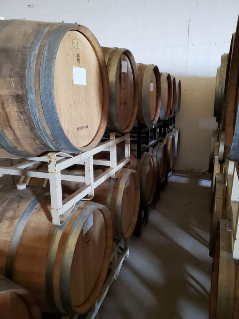Wine - from Tanks to Barrels - Stacked barrels.